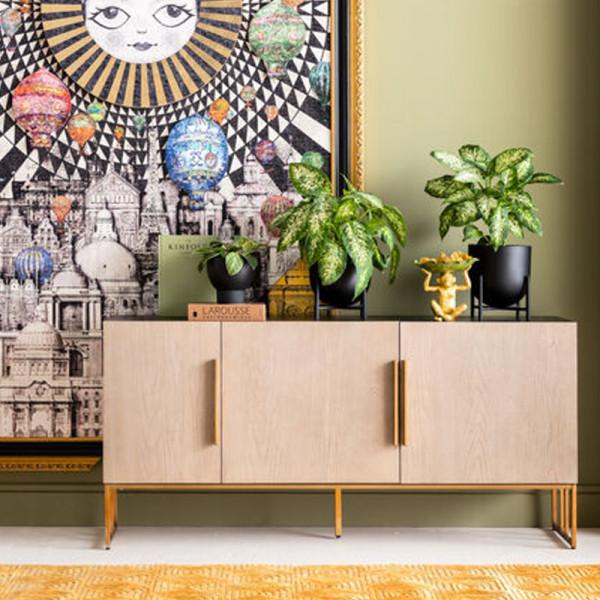 Design dressoir met marmer en koper
